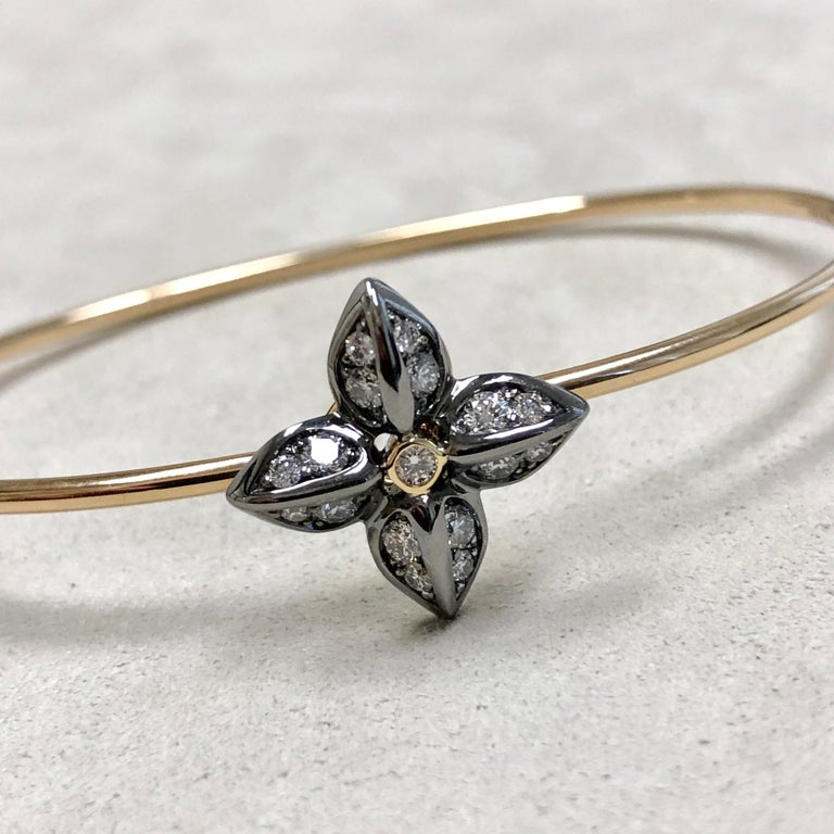 Created in 18 karat yellow gold & oxidized silver Champagne diamonds 0.55 ct approx Openable oval bracelet  Bracelet Inside wrap dimensions 66 mm by 59 mm  Bracelet can be sized Solid bangle wire Limited edition