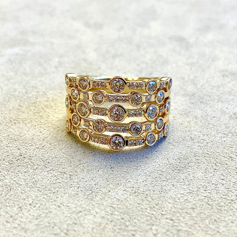 Created in 18 karat yellow gold Champagne diamonds 1.20 cts approx Band size US 7  Limited edition  About the Designers ~ Dharmesh & Namrata  Drawing inspiration from little things, Dharmesh & Namrata Kothari have created an extraordinary and