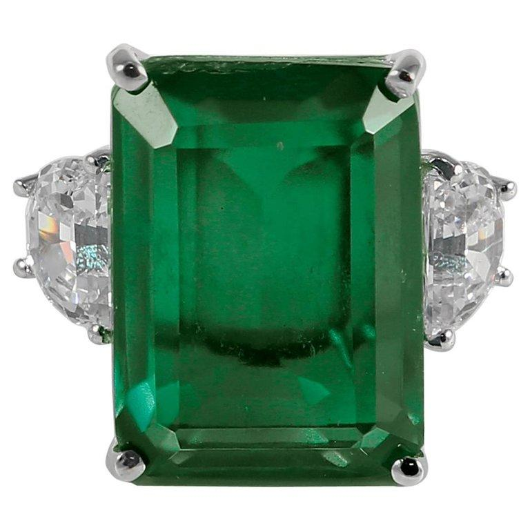 Synthetic 25 Carat Rectangular Step Cut Emerald Diamond Ring In New Condition For Sale In New York, NY