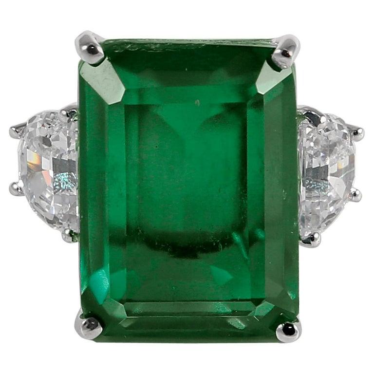 Synthetic 25 Carat Rectangular Step Cut Emerald Diamond Ring For Sale