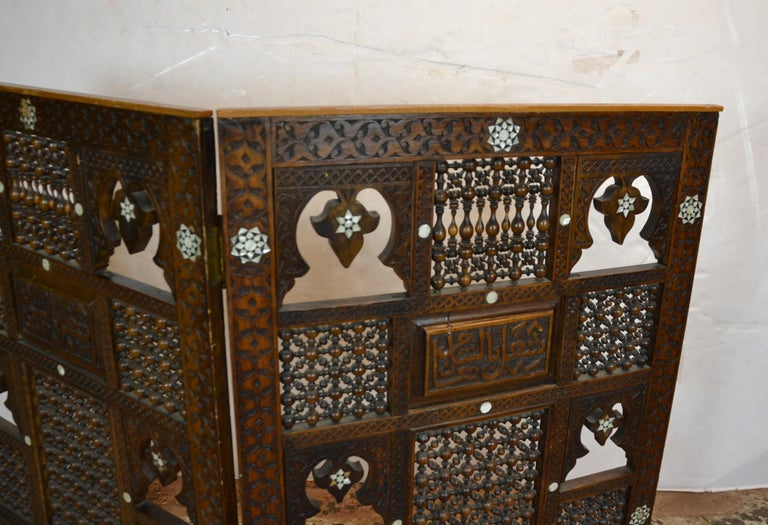 Syrian two-panel tabletop screen with mother of pearl inlay.