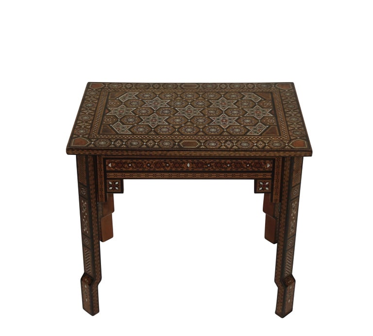 A side table Inlaid with multiple woods, bone, mother of pearl, and shell in geometric shapes on the top and sides. Syrian, circa 1950.