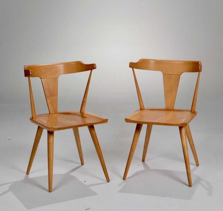 Maple t-back dining chair from the Planner Group series designed by Paul McCobb and manufactured by Winchendon, Massachusetts. Very good condition. We have 4 in stock, priced separately.