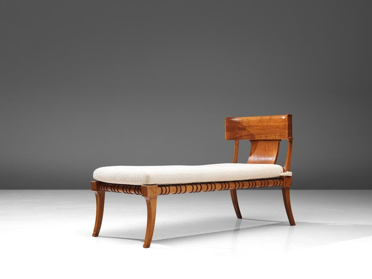T.H. Robjohn-Gibbings for Saridis of Athens, 'Klini' chaise loungemodel nr. 11, walnut, leather, fabric, United States, 1961  An ancient Greek inspired daybed by the British designer T.H.Robjohn Gibbings. This chaise lounge was part of the