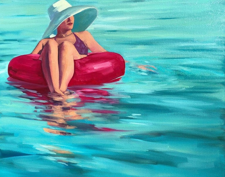 """T.S. Harris Figurative Painting - """"Drifting"""" oil painting of a woman in hat floating in a pink tube on teal water"""