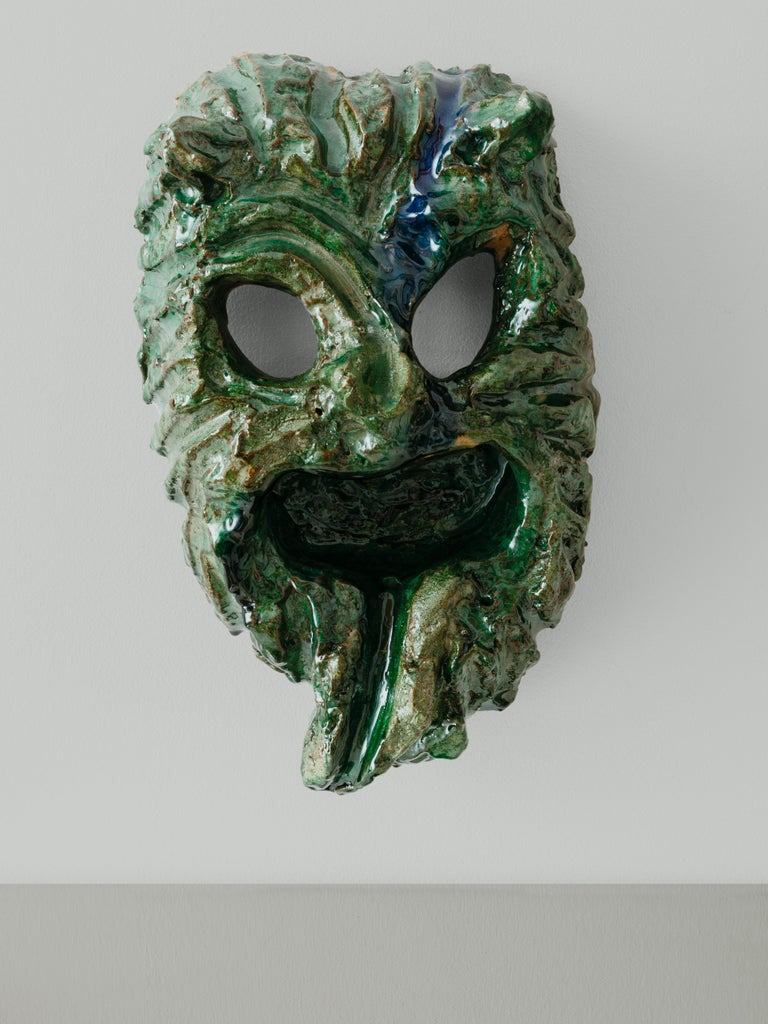 The apotropaic (warding off evil) mask from Seminara can be distinguished by its horns, wide eyes, mustache, and screaming mouth with its tongue sticking out. The masks are finished in enormous wood fired kilns, which adds an uncontrollable twist to