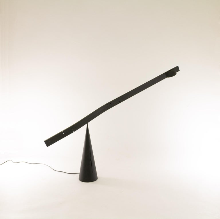 Tablatable lamp by Mario Barbaglia and Marco Colombo for Italiana Luce, 1988-1990.  Exceptional sculptural design with an adjustable and extendable arm that gracefully pivots on the peak of the cone base. The transformer of this halogen lamp