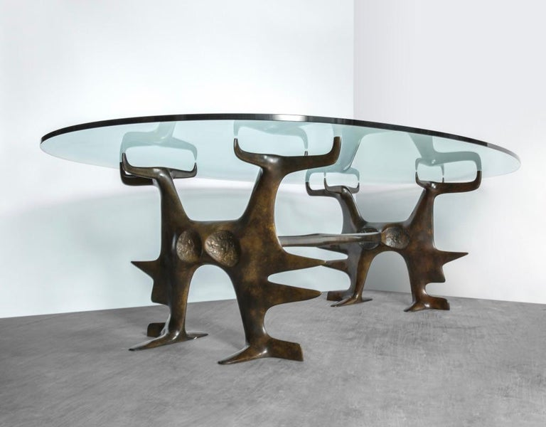 Table structure emulates the form of spider feet with struts Table surface in glass with ovoid shape Based on original design from the 1970s.