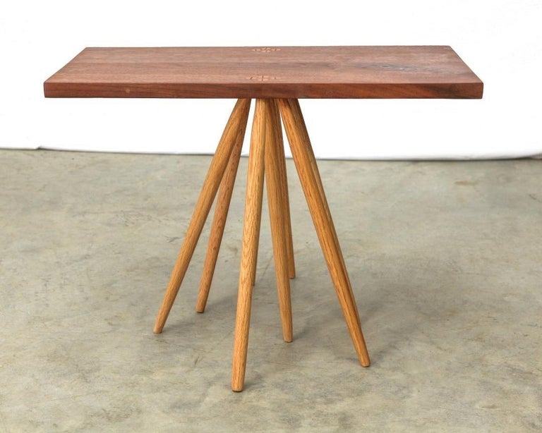 Table with rectangular top and eight legs by Michael Rozell, USA, 2021. Oak legs and walnut top.