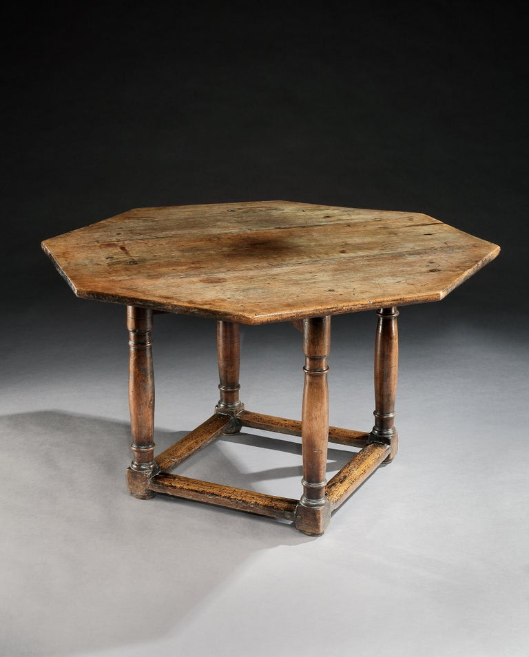 This table is of a rare and attractive form with characteristic Renaissance legs. It can serve as centre, dining or writing table. It has a lovely mellow color and lustrous patina. The top and base are original early 17th century associated elements