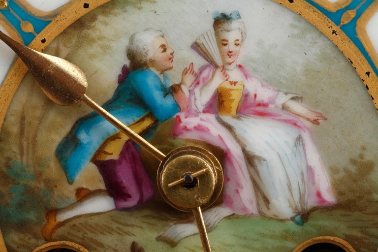 Gilt Table Clock in Ormolu and Porcelain with Galant Scenes For Sale