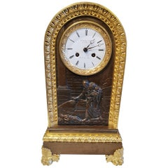 Table Clock in Patinated and Gilded Bronze from the 18th Century