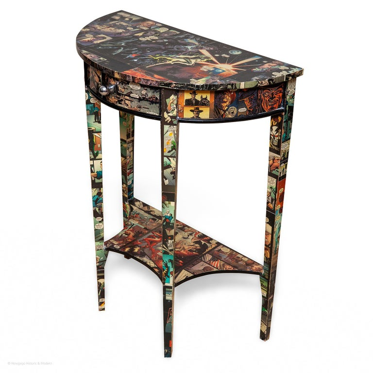 A highly unusual modern console table with cartoon decoration injecting humor and character into any interior  The semi-circular top sitting above a deep frieze with a fitted drawer with chrome knob. Standing on four tapering legs with a fitted