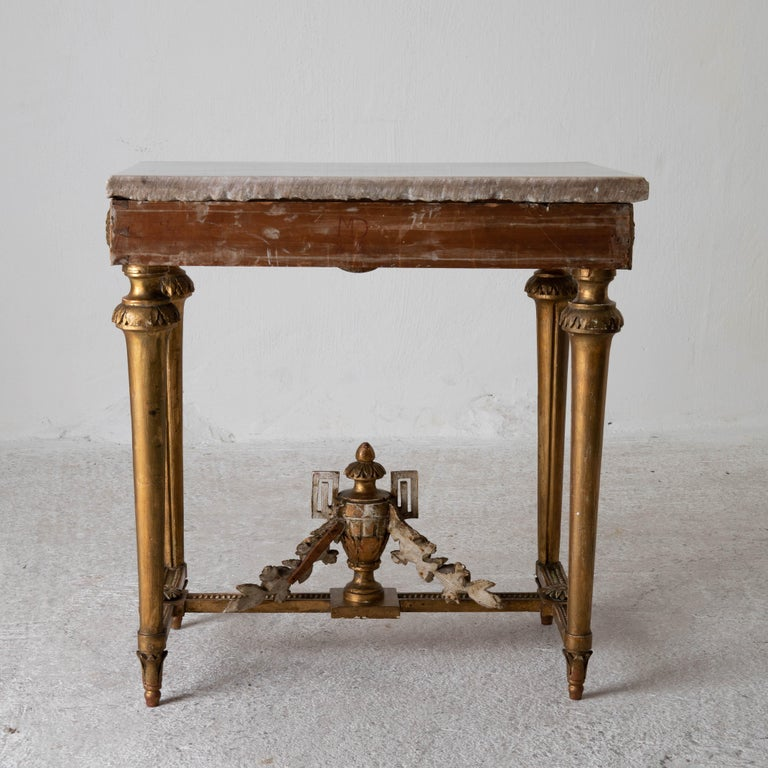 Table console rare quality Swedish early Gustavian gilded 18th century Sweden. A console table made during the Gustavian period in Sweden 1775-1790. Original gilding and white marble top. Decorated with laurel swags and channeled legs. Frieze edged