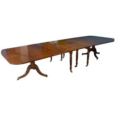 Dining table combined with another table on legs in extension.