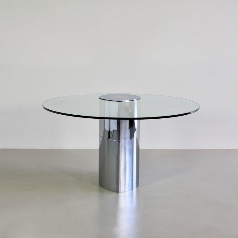 The Lunario table, consisting of a weighted chrome base with cantilevered glass top, both in matching elliptical shape. Superb minimalist design by Boeri. Gavina, the producing company of this table was taken over by Knoll International during