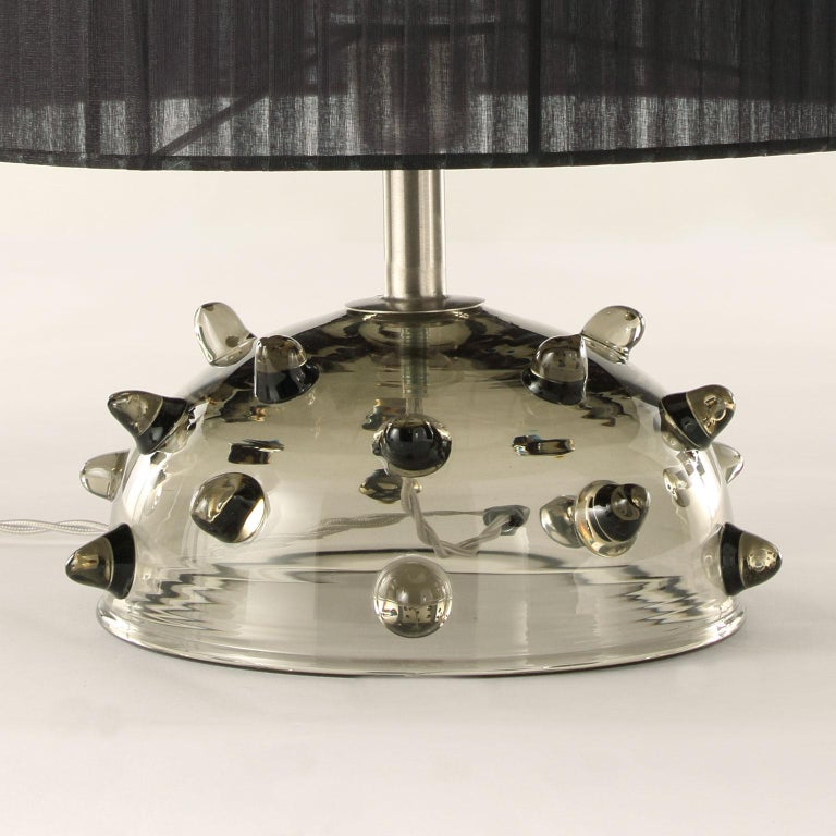 """Table lamp in grey artistic glass with clear """"bugne"""" (particular application in glass on the base), black organza handcrafted lampshade.  Size: 35 length x 41 height"""