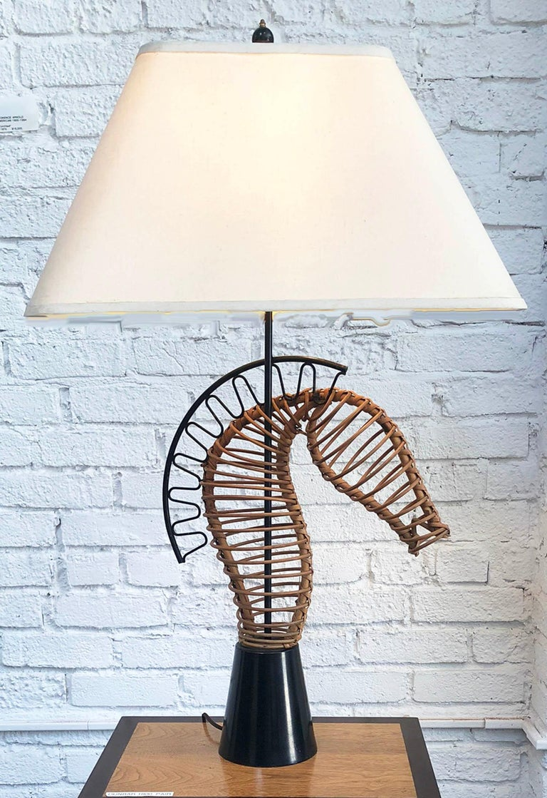 Rare sculpture table lamp by Frederick Weinberg. Rattan and iron on a lacquered wood base. All original, 1950s. The lamp is sold without the shade. Measurements are without the shade.