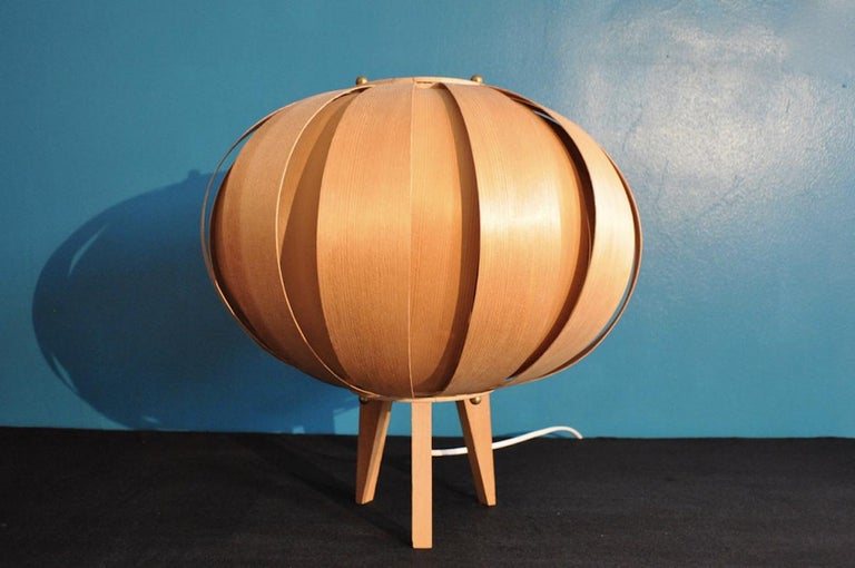 Nice and original table lamp designed by Hans-Agne Jakobsson and produced by Markaryd AB in the 1950s. The lamp is made in pin wood and with brass details.