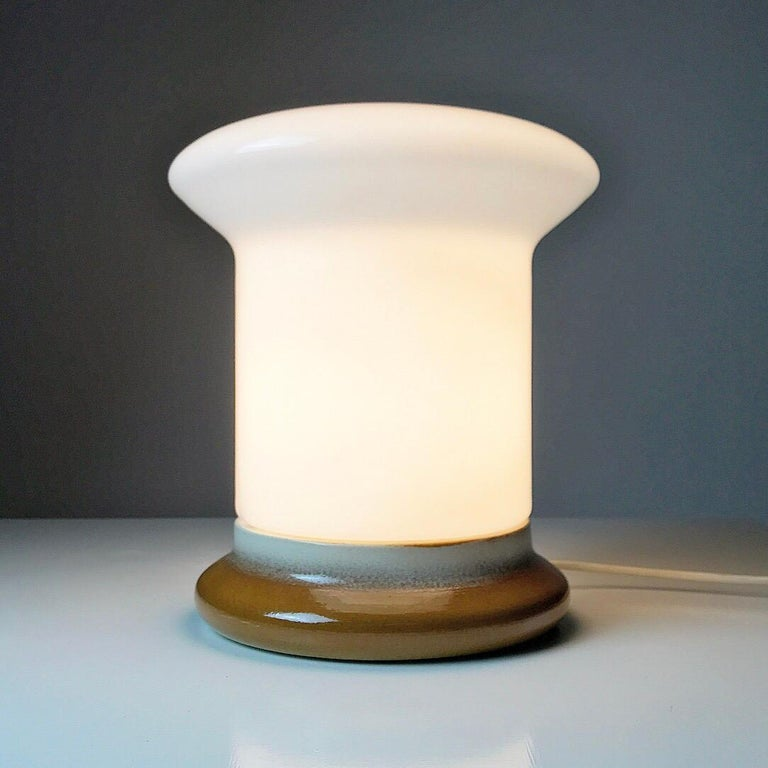 Just have a look at the beautiful and large shaped mushroom opaline glass combined with brown glazed ceramic base, it's just a stunning piece of high quality design.  Lit or unlit this Bohemian / Space Age 1960s piece will steal attention.   The