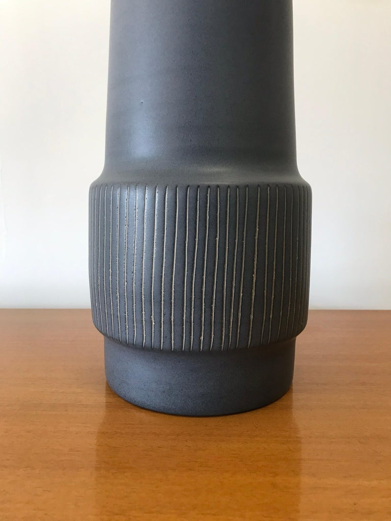 """Large ceramic lamp by famed ceramicist duo Jane and Gordon Martz. Flat blue glaze with incised detail. New harp and new shade  Meausres: Overall 28.5"""" tall 15"""" wide   Ceramic portion 15.5"""" ceramic  6.75"""" wide ceramic."""