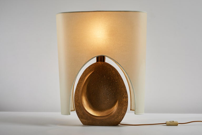 Table lamp by Pragos. Designed and manufactured in Italy circa 1960s. Bronze with original shade. The base is signed edition 18/150. Original cord. Takes one E26 100w maximum bulb. Bulb provided as a one time courtesy.