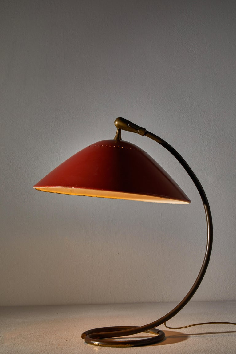 Table Lamp by Stilnovo. Manufactured in Italy, circa 1950s. Original enameled metal, brass. Original cord. We recommend one E14 100w maximum candelabra bulb. Bulb provided as a one time courtesy.