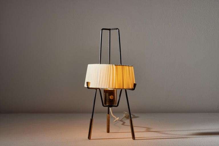 Table lamp by Stilnovo. Manufactured in Italy, circa 1950s. Brass, enameled, metal, acrylic ribbon shade. We recommend one E14 40w maximum bulb. Bulb provided as a one time courtesy. Retains original manufacturer's label.