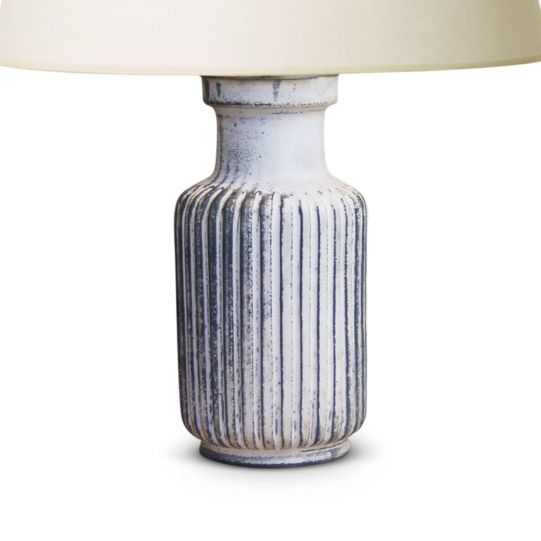 Table lamp by Svend Hammershøi (1873-1948) for Kähler Keramik, having an albarello / apothecary jar form with deep carved vertical flutes around its perimeter, in stoneware glazed in a rare rose-black variation of the white-black tin glaze developed