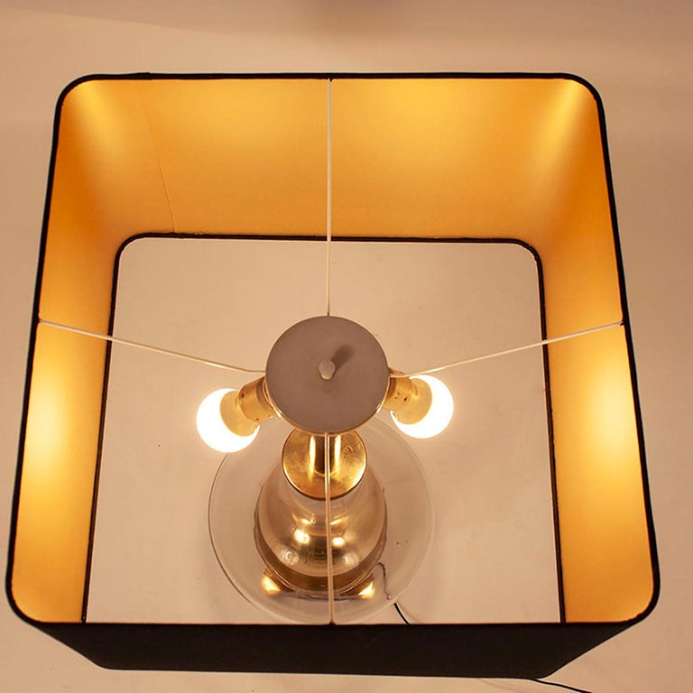 Table lamp designed by Lumica, 1970s. Gold brass and glass, midcentury.