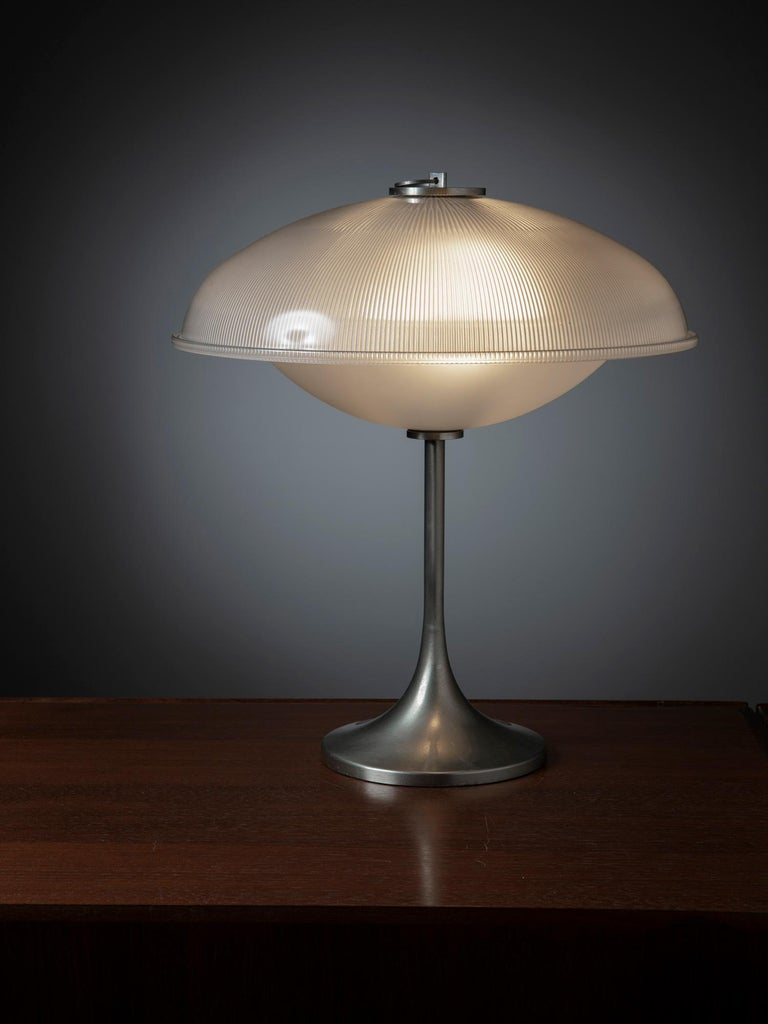 Rare table lamp with metal base and prismatic glass shades. The lamp has visual connections with the model manufactured by Gregotti for Arredoluce.