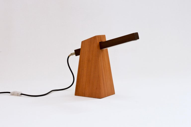 Table lamp in wood and LED. Lamp base is made in reclaimed Peroba wood and light stick is made in Canela Preta, a native Brazilian wood.  Guitar plug controls on/off  Matraca lamp is an artisanal product designed and manufactured in Rio de