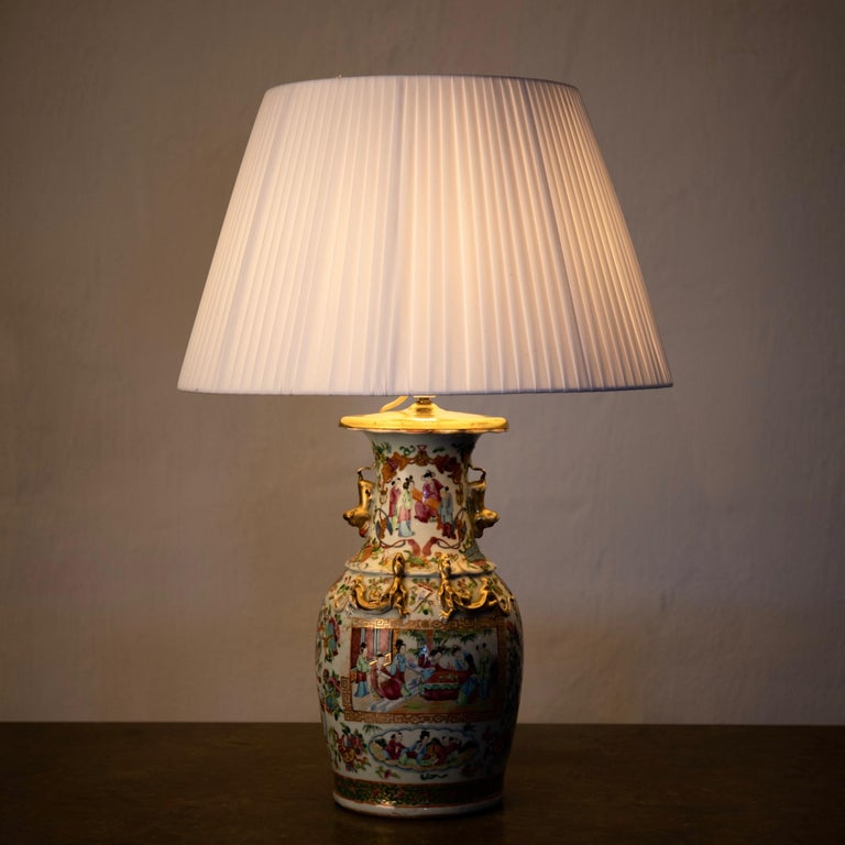 Table lamp oriental colors 19th century, China. A table lamp made during the 19th century in China. Multicolored with gilded details.