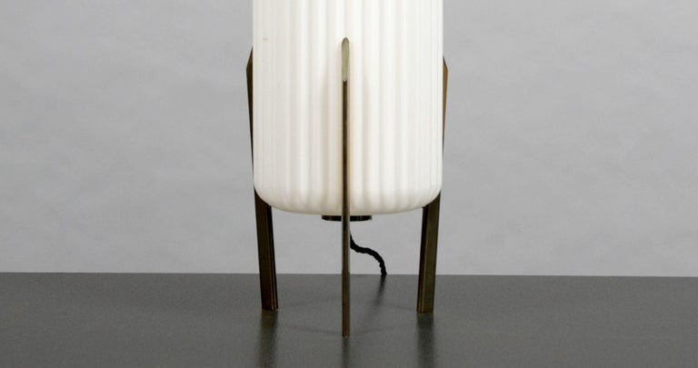 Brass table lamp with ribbed opaque glass shade attributed to Arteluce.