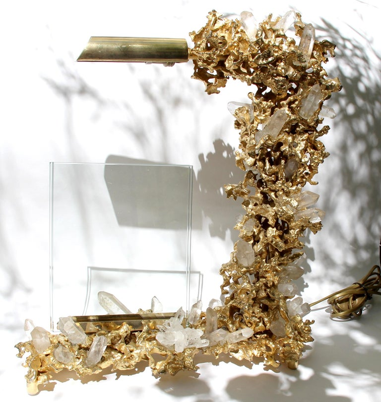 Beautiful lamp with photo holder in exploded bronze gilded in 24 K fine gold, supporting numerous rock crystals.  Claude-Victor Boeltz, born in 1937 in Paris Complete artist (sculpture, painting, foundry, pottery, ironwork),