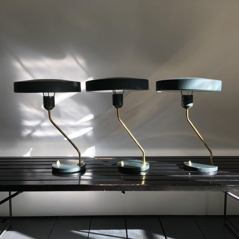 Vintage desk lamps by Louis Kalff for Philips, Netherlands, 1950s. Model Z with a hole in the shade allowing light to shine both above and below. These lights are often paired with a silver or gold crown bulb.  Three lights available with their