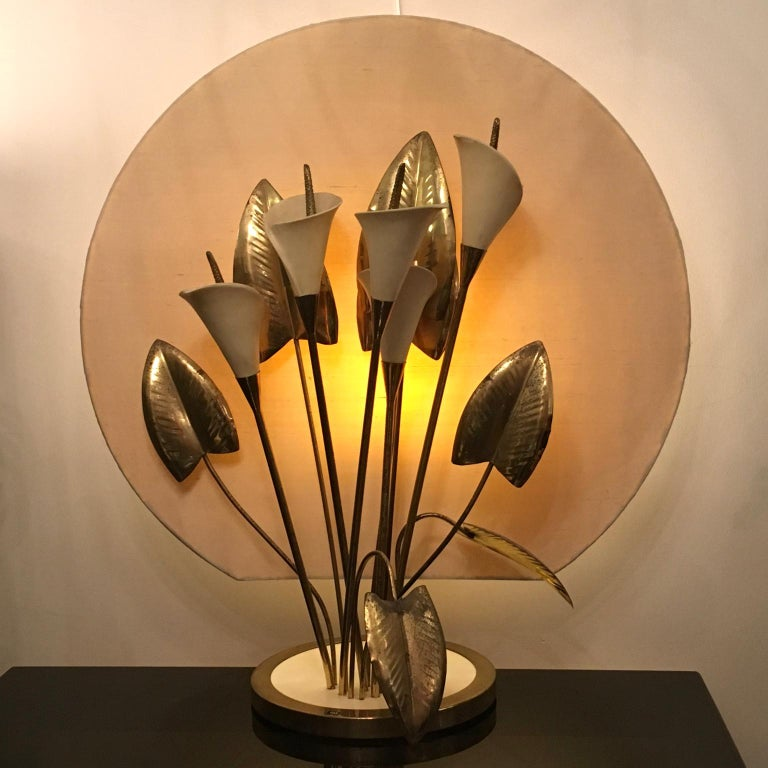 A very unusual and good quality brass and ceramic light where the lillies and brass leaves can be repositioned and rearranged as needed. The background is ivory silk and can also be recovered in any color you like, Italy, 1960s-1970s, possibly Barbi.