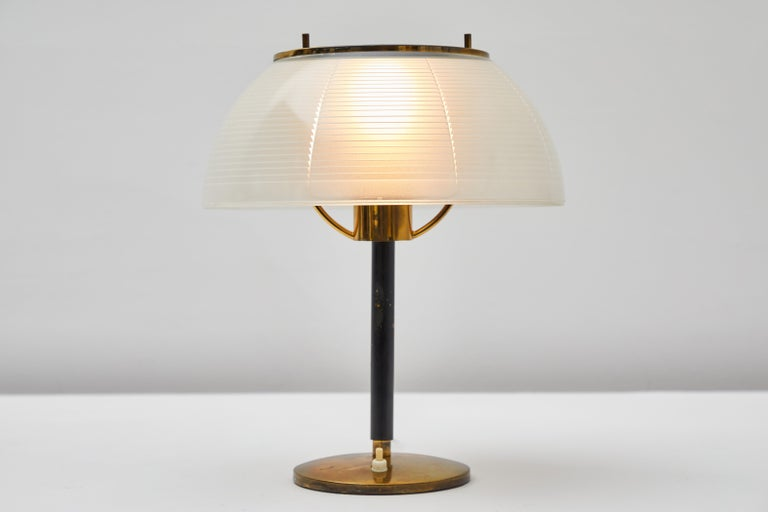 Table Lamp by Tito Agnoli for Oluce. Designed and manufactured in Italy, circa 1960s. Glass, enameled metal, brass. Original cord. Takes one E27 100W maximum bulb. Bulbs provided as a one time courtesy.