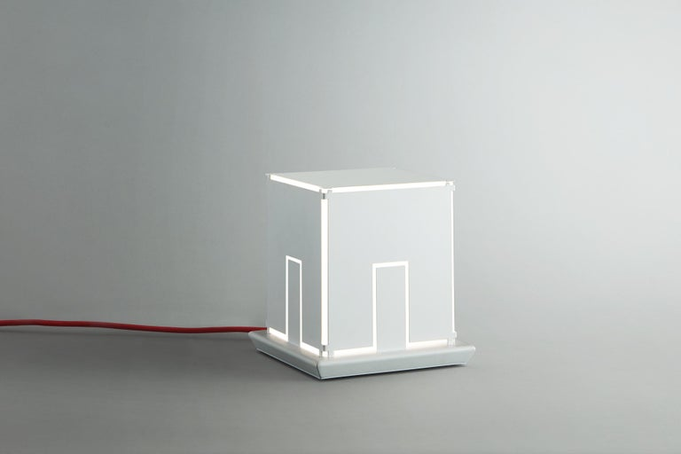Table light LightHouse artwork by artist Massimo Uberti limited edition white varnished metal The new artwork of light by the artist Massimo Uberti at Pollice Light Gallery  LightHouse is a handcrafted product, realised with care by Pollice