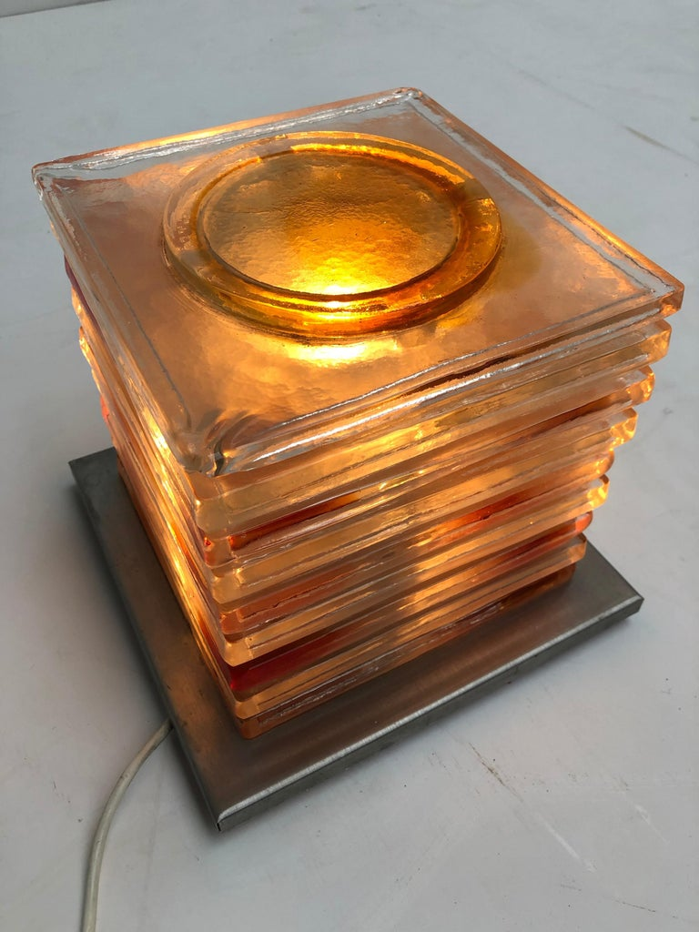 1970s table lamp by Albano Poli (the founder of Poliarte) for Italian artisan lighting company Poliarte.  This Italian lighting sculpture is made of square and stacked coloured glass pieces mounted on a stainless steel base   In good original