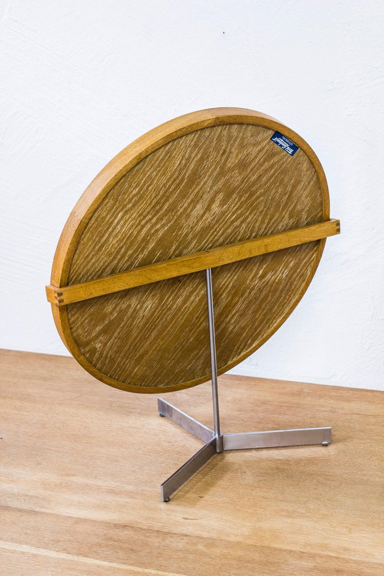 Rare large table mirror designed by Uno & Östen Kristiansson. Produced by Swedish company Luxus during the 1950s. Frame made from solid lime treated oak with leather lining holding the mirror in place. Zipper joinery on the frame and the back piece.