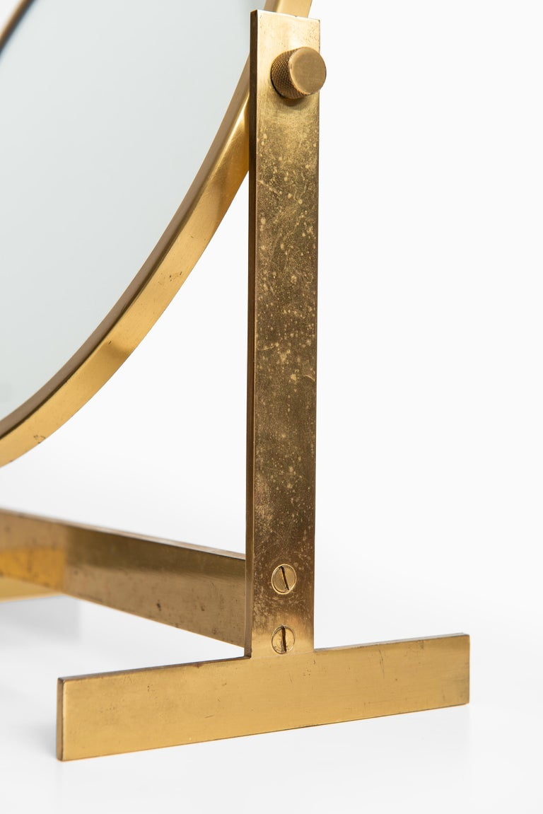 Swedish Table mirror in brass produced in Sweden For Sale
