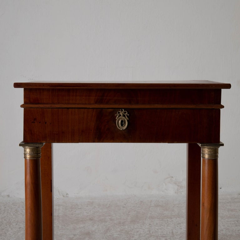 A sideboard made during the Karl Johan period early 19th century in Sweden. Made from mahogany and decprated with brass details and hardware. A drawer in frieze.