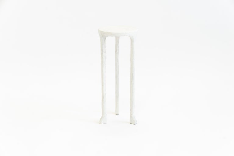 """Table No. 3 plaster by JM Szymanski Dimensions: R 8"""" x H 20""""  Materials: Carved steel, plaster finish  Our classic side table is hand plastered adding texture and depth to an already beautiful design.  Jake Szymanski lives and designs in New"""