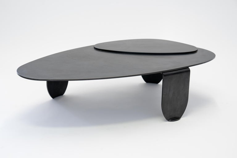 """Table no. 7 by JM Szymanski Dimensions: L 52"""" x W 30"""" x H 13""""  Materials: Blackened waxed steel  Abstract shapes are cut from 3/8"""