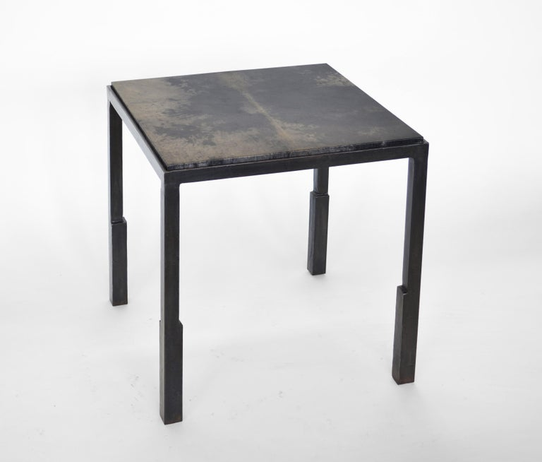 """Table no. 9 parchment by JM Szymanski Dimensions: L 18"""" x W 18"""" x H 20"""" Materials: Blackened waxed steel, parchment inset  A blackened steel table frame is hand-sculpted into unique geometries. This table is finished in wax so that the handmade"""