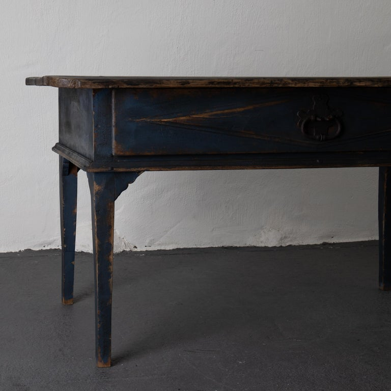 Table Swedish black blue, 19th century, Sweden. A table made during the early 19th century in Sweden. Painted with Laserow black on the top and a deep dark blue base. Carved drawer with diamond shapes in frieze. Original cast iron hardware. Tapered