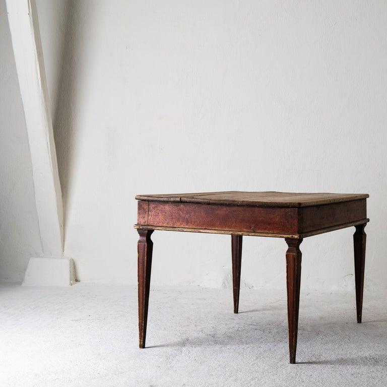 Table Swedish Gustavian 18th century original paint Sweden. A side table made during the 18th century in Sweden. Original reddish finish and paint. Tapered and channeled legs.