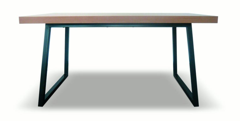 Table with metal base made of MDF lined beechwood. The base is bent, galvanised metal, oven-painted with acrylic grey color. Measures: 86 cm x 140 cm x 76 cm  The adjacent stool (one) is made of compressed MDF, lined with beechwood. Measures: 46