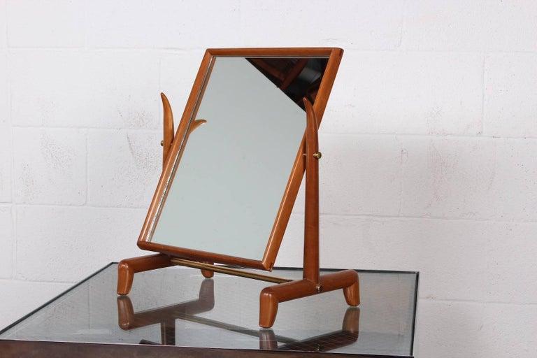 A rare tabletop mirror designed by T.H. Robsjohn-Gibbings for Widdicomb.